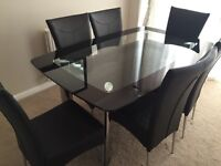 Harvey's glass dining table with 6 chairs