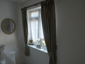 Pair of light green Curtains with tie backs and hooks