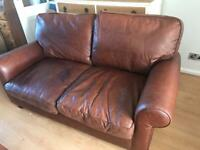 Laura Ashley chocolate brown leather two seater sofa.