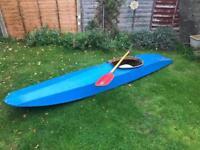 Vintage wooden canoe with oar