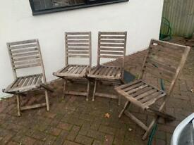Folding outside wooden chairs needs restaining cheap spare ones