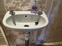 Cloakroom wash basin, grey with taps and waste in excellent condition