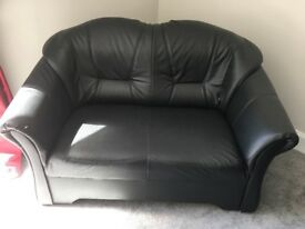 Two seater black sofa and chair