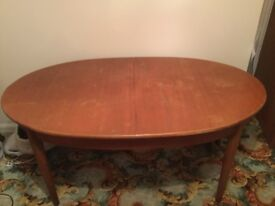 A LARGE OVAL DINING TABLE