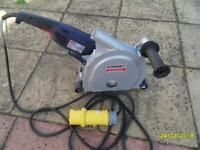 A SPARKY WALL CHASER. IN AS NEW CONDITION MODEL FK652