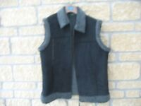 Black faux-fur zipped gilet. Size 14, unworn