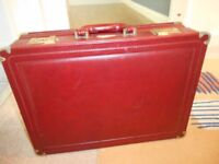 Faux leather brief case. Combination lock in good condition