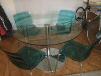 Round glass dining table & contemporary acrylic or wood chairs set