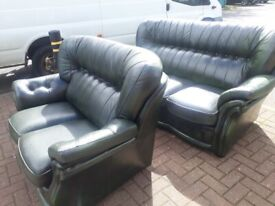 2 and 3 seater dark green leather sofa,s