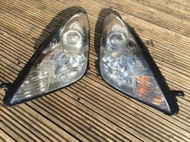 Pair of headlamp headlight clusters from 2003 Toyota Celica