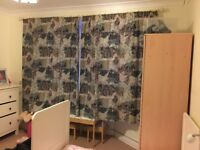 Beautiful pair of curtains with curtain pole