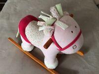 Pink child's rocking horse