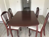 Dining table and 4 chairs for sale,scratch marks present.