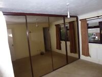 Four sliding mirror wardrobe doors