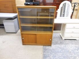 solid wooden bookcase display cabinet with sliding glass doors. excellent condition. can deliver