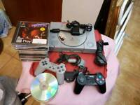 PlayStation 1 pal with controllers & games