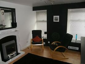Black leather lounge chair - £78 ono