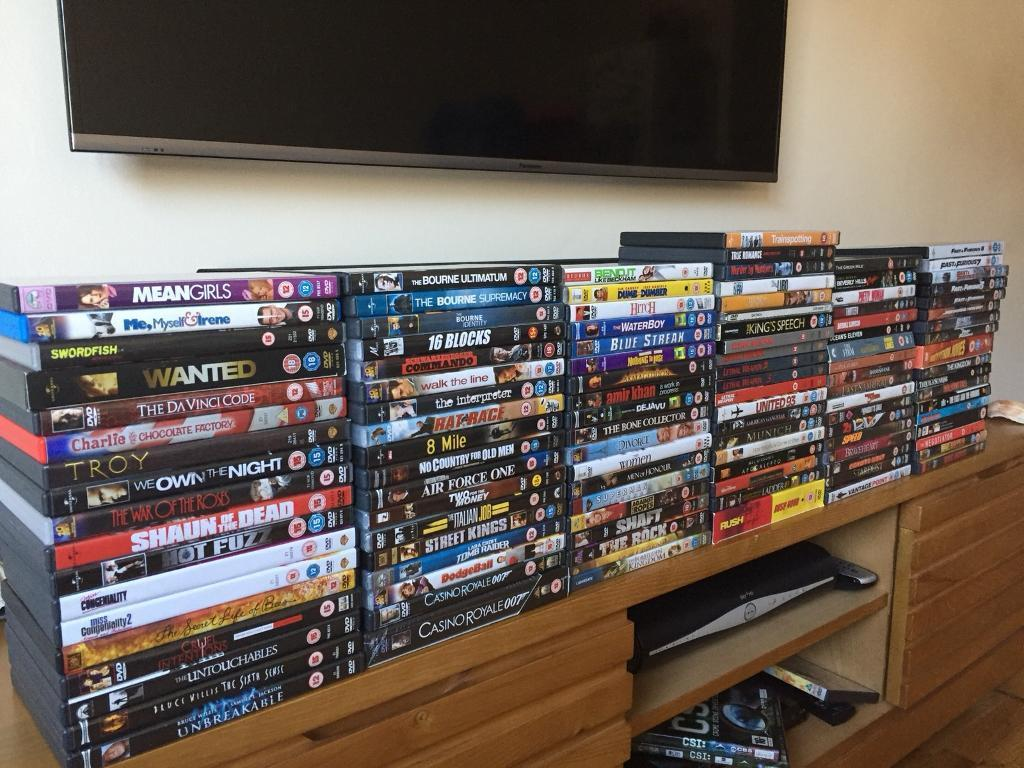 *SOLD* 100 DVD's - MINT CONDITION