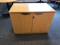 Used Wooden, 2 Door Storage Cabinet. One Available.