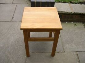 A square pine plant stand / lamp table.