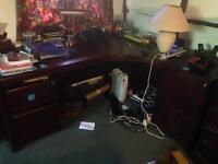 Dark wood desk with storage cabinets