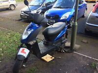 Agility 125cc moped