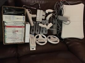 Wii console with all 2 handsets, balance board and games included