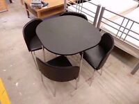 Round black dining table with 4 chairs