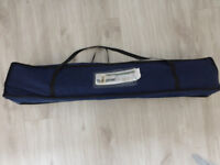 Aluminium framed camping bed with blue fabric complete with storage/carrying bag