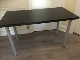 Ikea table , black, with 4 tubular grey legs. Very good condition. Possible local delivery.