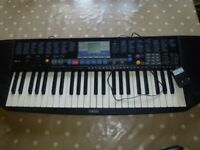 Yamaha keyboard with adaptor (can take batteries also)