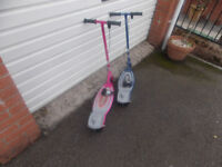 2 childs electric razor scooters