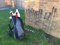 Full set of golf clubs irons 3,5 woods putter bag and trolley