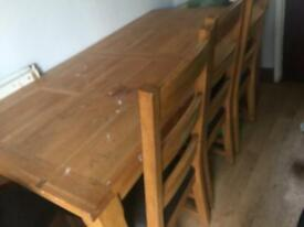 Wooden table with 5 chairs