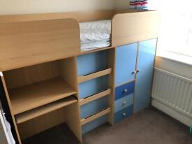 A nearly new high sleeper cabin bed