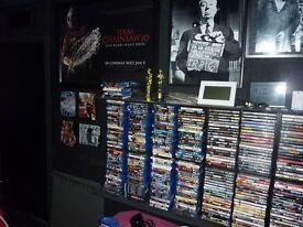 100's of blu ray and DVD movies, plus wall racks