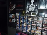 100's of blu ray and DVD movies, plus wall racks