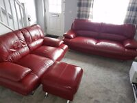Red Leather 3 seater, 2 seater sofa and footstool for sale