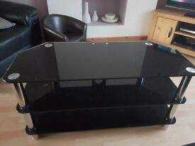 Black Glass TV stand. In good condition.