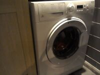 Hotpoint washing machine, less than year old, has broken door but otherwise works great.
