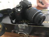 Nikon D3100 DSLR camera with bag