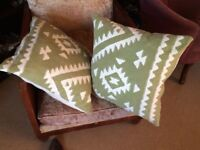 Two large green and cream aztec design cushions in excellent condition