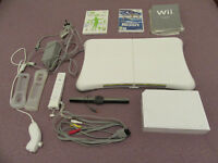 Nintendo Wii console, balance board and games