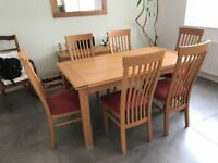 Extendable Oak Dining table and 6 high backed chairs with matching sideboard