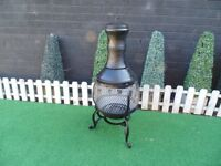 BLACK METAL CHIMENEA VERY SOLID AND IT'S IN GOOD CONDITION 48/85 cm £30