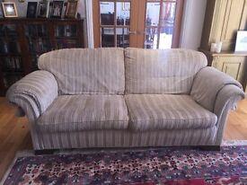 Sofa in beige velour fabric.