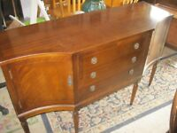 ORNATE SHAPED SIDEBOARD. ATTRACTIVE. 3 CENTRAL DRAWERS, MATCHING END CABINETS. DELIVERY AVAILABLE