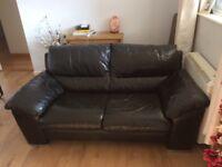 Genuine leather 2 x 2 seater black sofas.