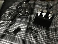 Logitech G920 Steering wheel, pedals and shifter.