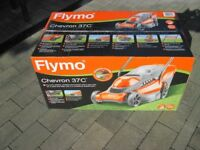 FLYMO ELECTRIC LAWNMOWER WITH POWERFUL 1600w MOTOR 37cm CUT BRAND NEW SEALED BOX